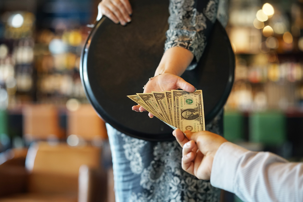 A photo showing how much to tip a bartender.
