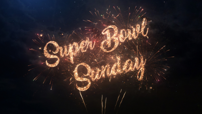 Fireworks spelling out the words Super Bowl Sunday to celebrate the Super Bowl date on the first Sunday of February.