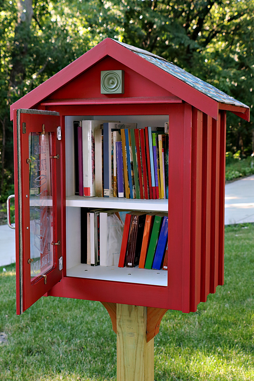 A little library with the door open showing where to donate books.