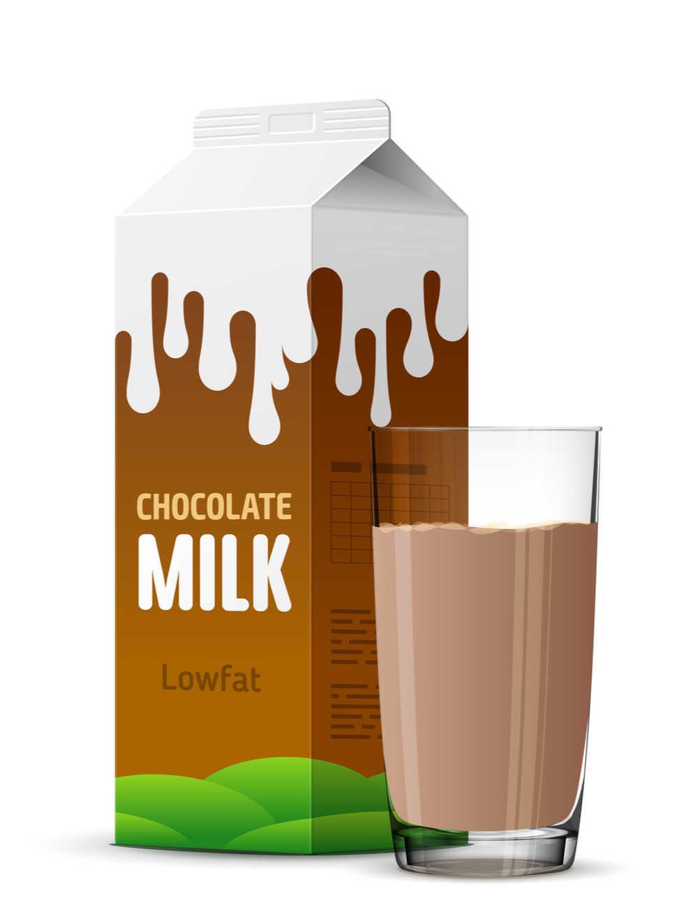 A cartoon style carton of lowfat chocolate milk beside a glass of chocolate milk.