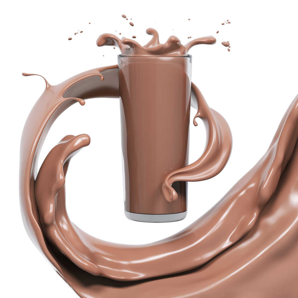 A glass of chocolate milk with chocolate milk swirling through the air around the glass.