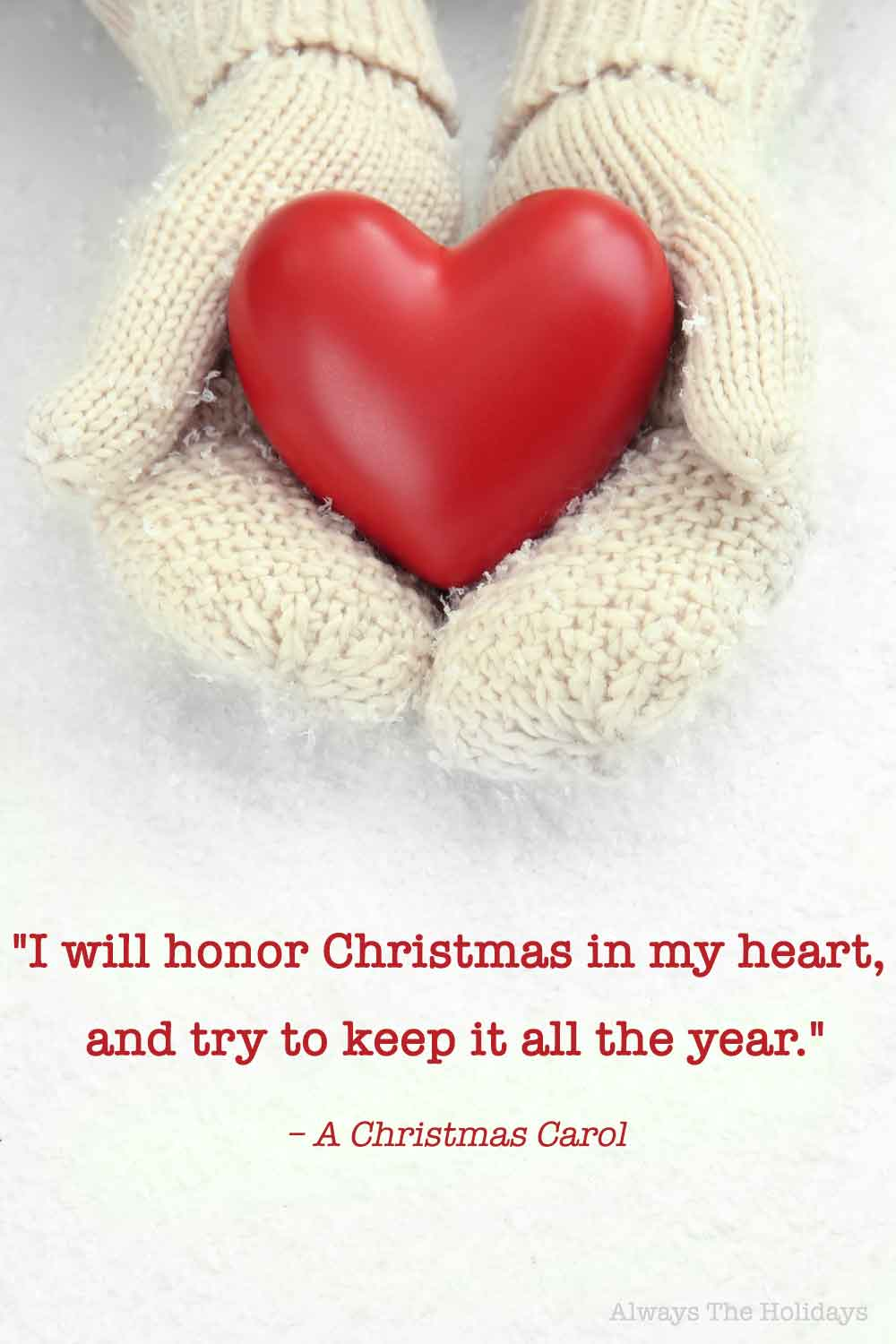 Hands wearing white mittens holding a red heart with a Christmas quotes from movies text overlay.