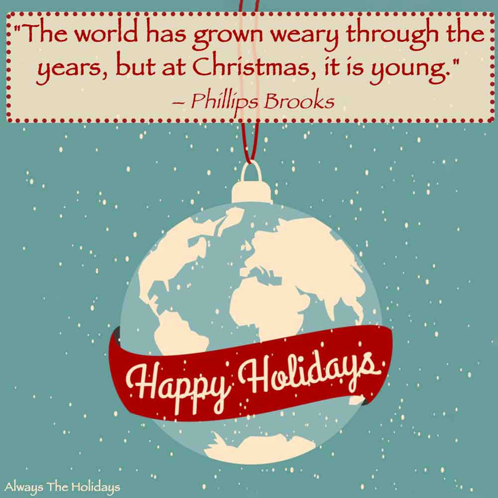 """A Christmas ornament of the world with a banner that says """"Happy Holidays"""" with a happy holidays quote text overlay on top."""