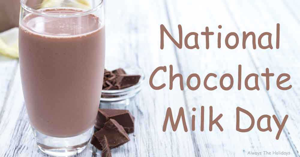 """A glass of a chocolate milk on a white wooden background next to chocolate with a text overlay that reads """"National Chocolate Milk Day""""."""