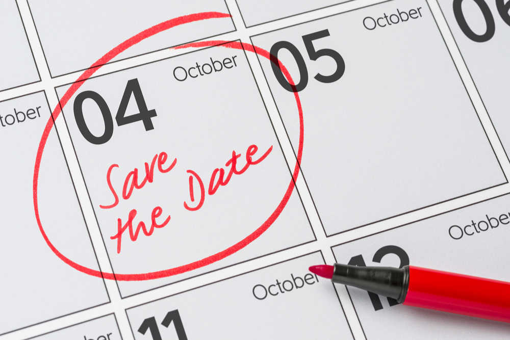 """October 4th circled on a calendar with red pen, and a note written on the day that says """"save the date""""."""