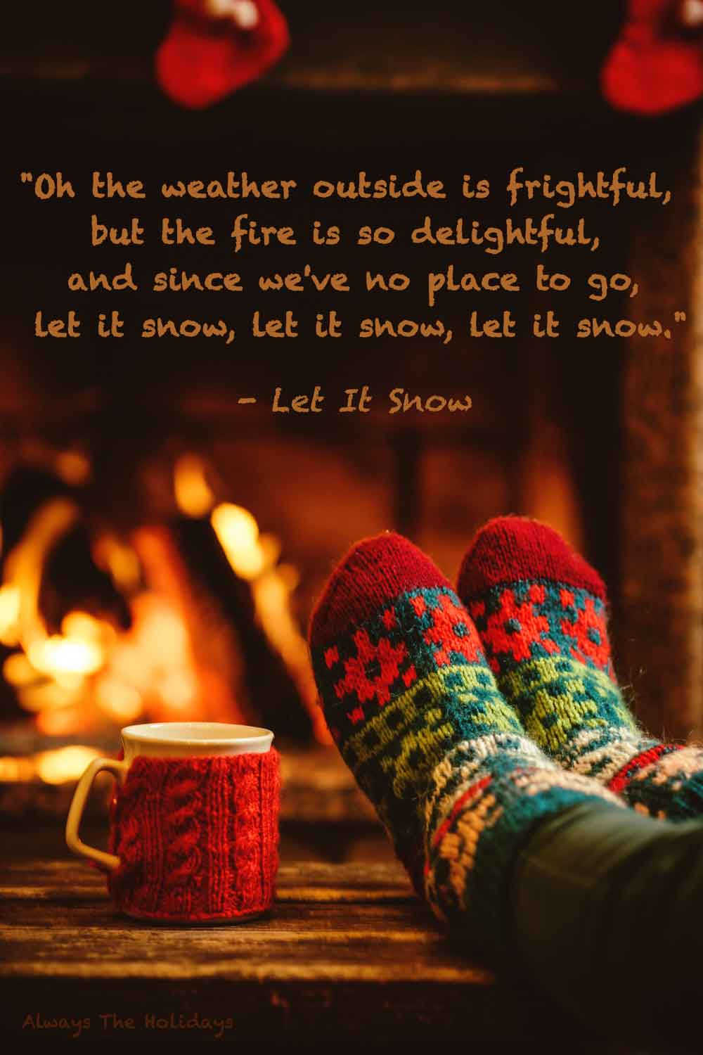 Feet on a coffee table with festive socks next to a mug in front of a crackling fire with a text overlay of quotes from Christmas songs.
